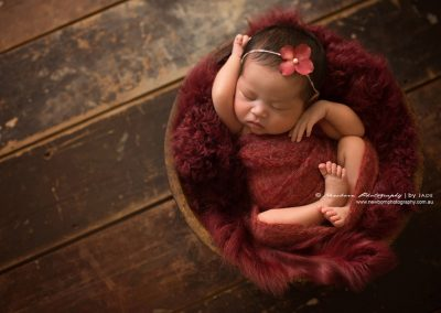 Chinese-newborn-girl-in-red-fabric