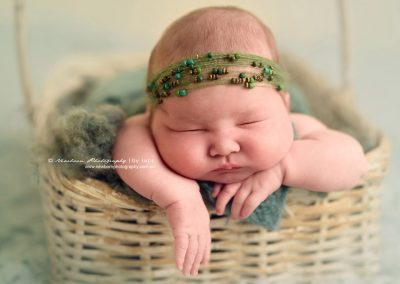 Chubby-cheeks-newborn-girl-photography