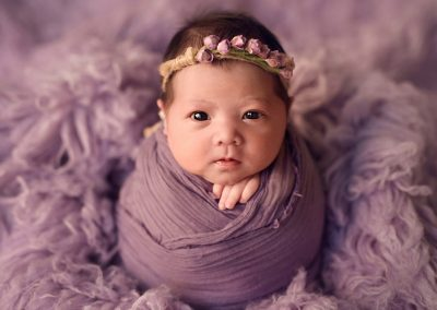awake-newborn-girl-in-purple