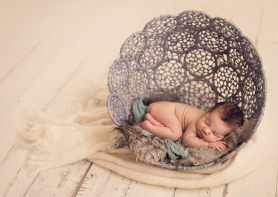 beautiful-newborn-boy-photography-in-blue-basket