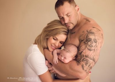 chubby-newborn-girl-in-strong-tattoo-dad-arm-and-beautiful-mum