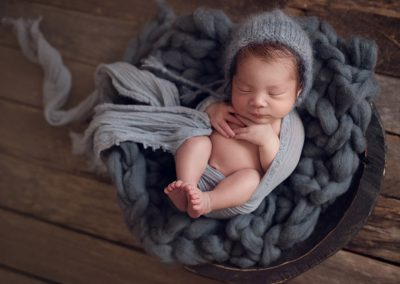 cute-baby-laying-blue-gray