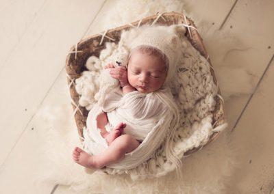newborn-baby-boy-cuddling-bunny